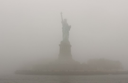 Statue of Liberty in the fog, New York
